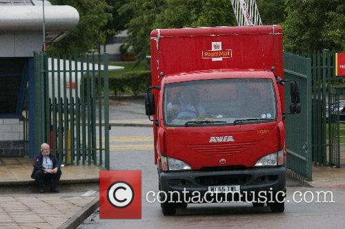 A lone picket is resigned as mail lorrys...