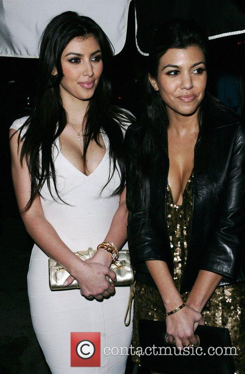 Kim Kardashian and Kourtney Kardashian arriving at a Pre Grammy party at Contact 1