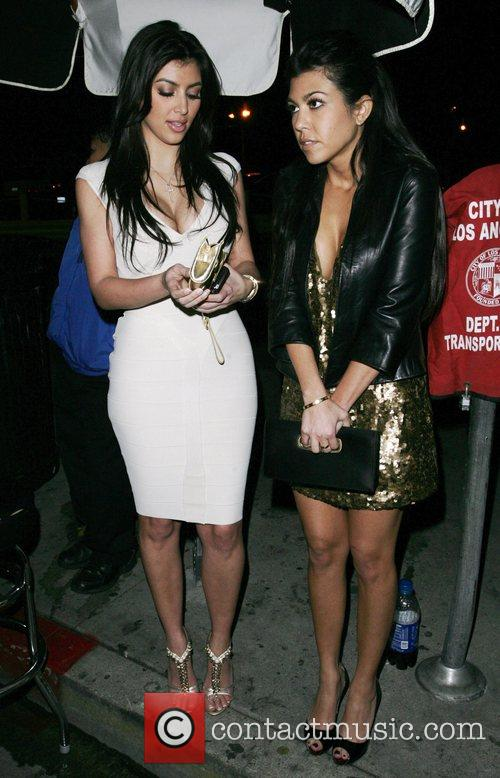 Kim Kardashian and Kourtney Kardashian arriving at a Pre Grammy party at Contact 2