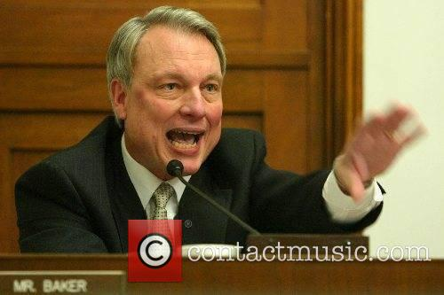 Rep. Baker at the hearing on predatory practices...
