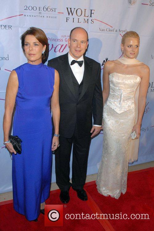 Princess Caroline, Prince Albert of Monaco and guest...