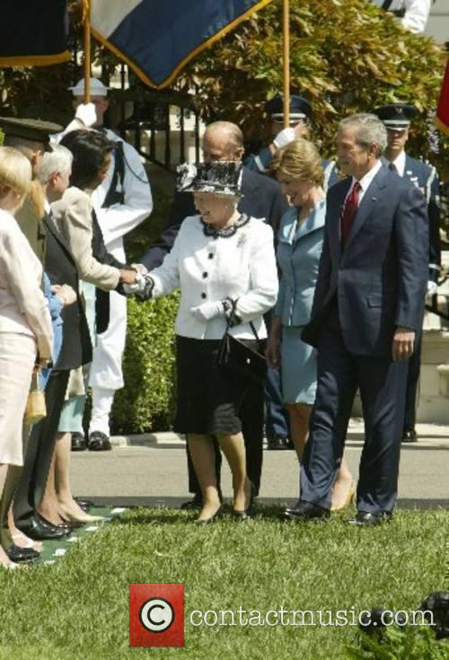 HRH Queen Elizabeth II greets Condoleezza Rice with...