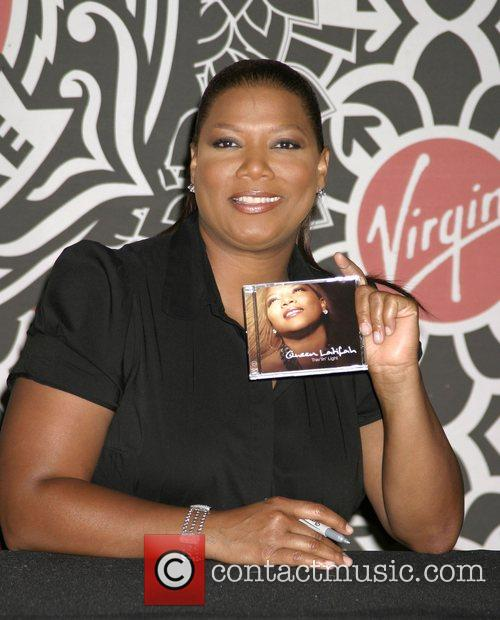 Queen Latifah makes an in-store appearance to sign...