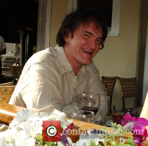 Quentin Tarantino enjoying lunch with a mystery woman...