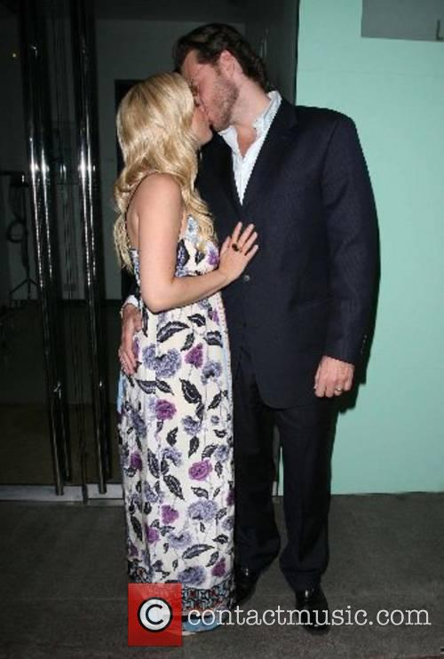 Share a kiss before leaving Nobu restaurant in...