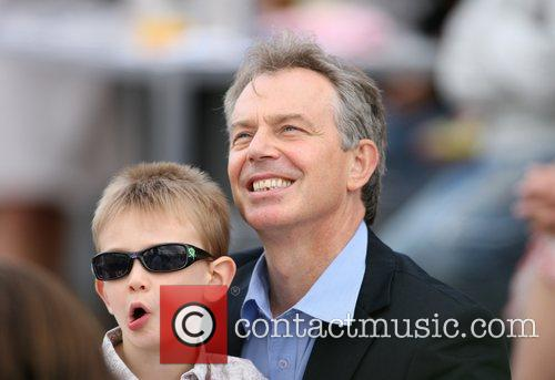Tony Blair  looking relaxed as he watches...