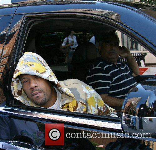 American rapper Redman (aka Reginald 'Reggie' Noble) sitting...