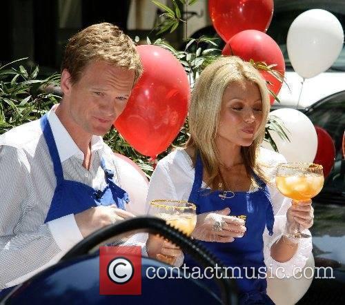 Neil Patrick Harris and Kelly Ripa filming a...