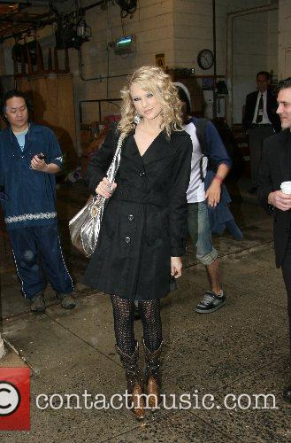 Taylor Swift leaving ABC Studios after appearing on...