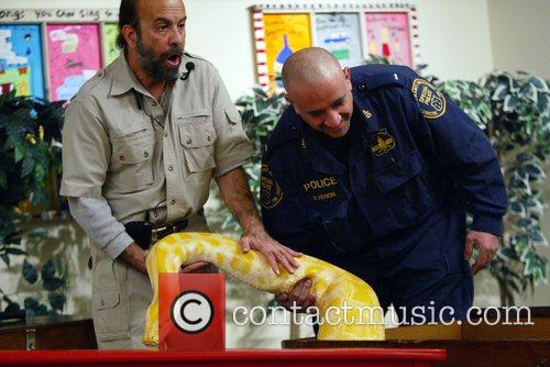 Michael Shwedick is assisted with an Albino Anaconda...