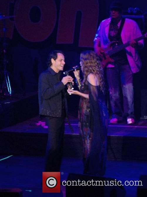 Marc Anthony and Jennifer Lopez performing at the...