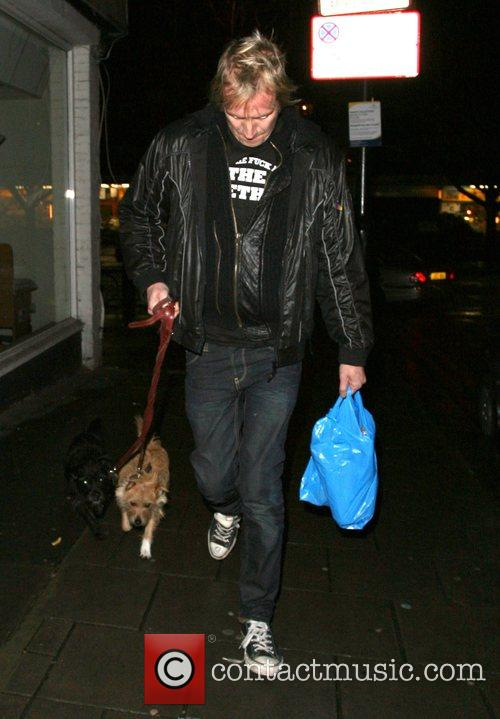 Rhys Ifans arrives home with his girlfriend Sienna...
