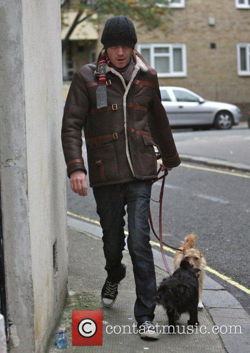 Rhys Ifans takes Sienna Miller's dogs Porgy and...