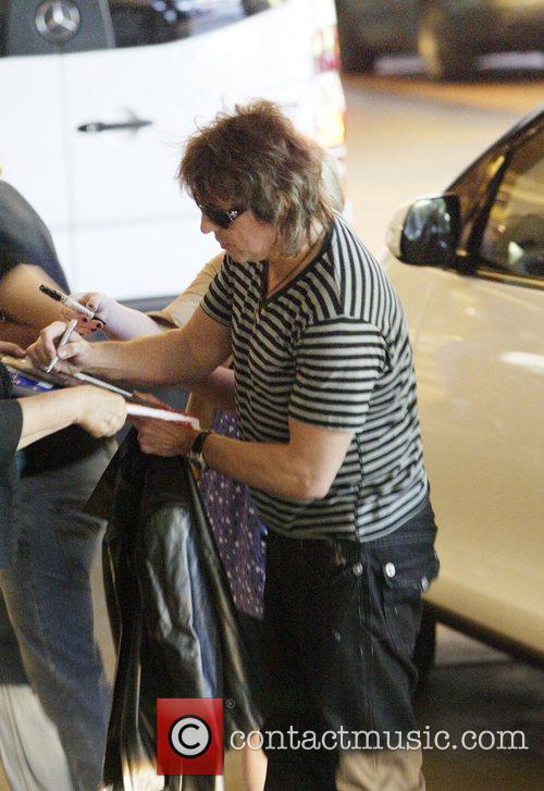 Bon Jovi guitarist Richie Sambora signs autographs for...