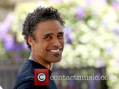 Retired basketball player Rick Fox out jogging in...