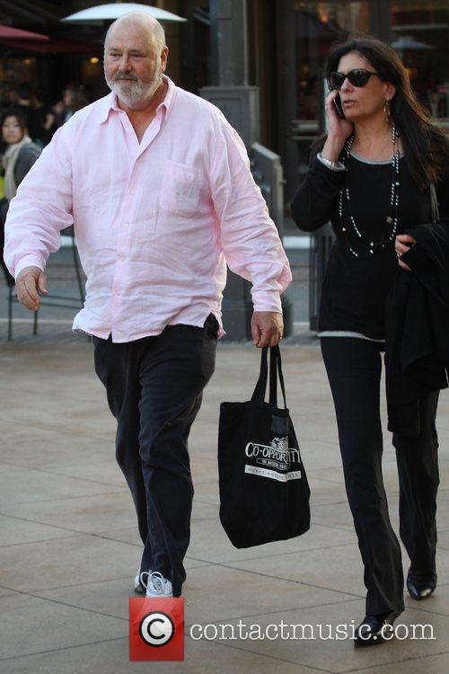 Rob Reiner wearing a pink shirt and traniers...