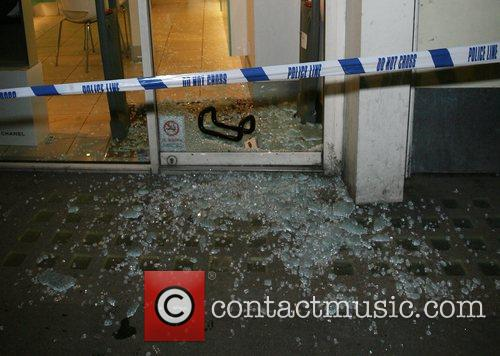 Robbers left a trail of broken glass, after...