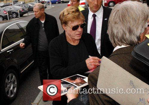 Robert Redford arriving at Tempelhof airport and signing...