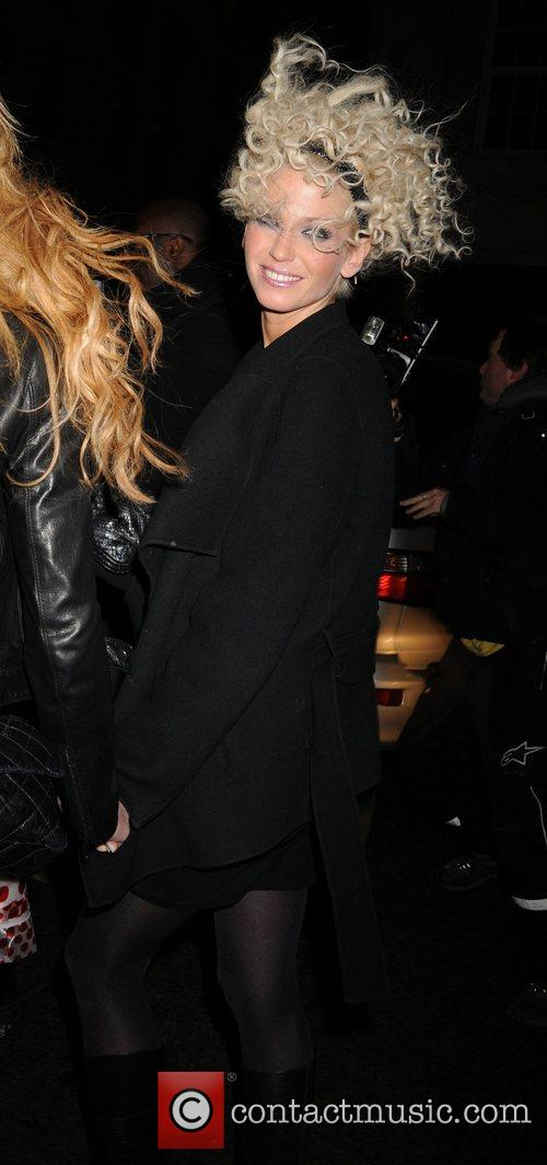 Sarah Harding showing off a new curly hairstyle...