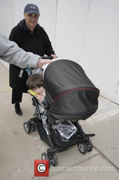 Leaving The Ivy restaurant with her grandson after...