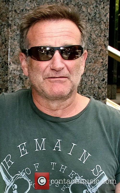 Robin Williams out for a walk dessed in...