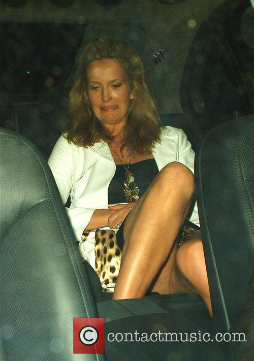 Penny Lancaster Getting in to a car after...
