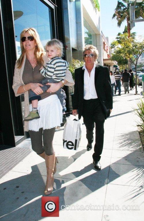 Rod Stewart walking down Beverly Drive with his...