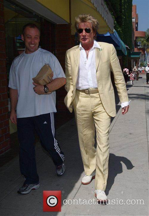 Rod Stewart leaves a medical building with his...