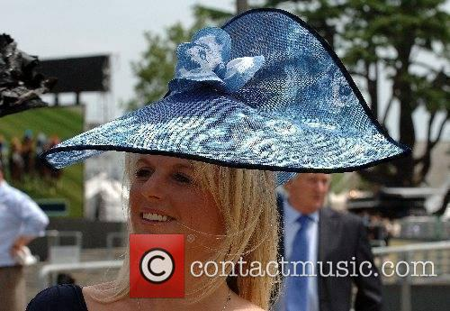 A lady in a an elaborate hat on...