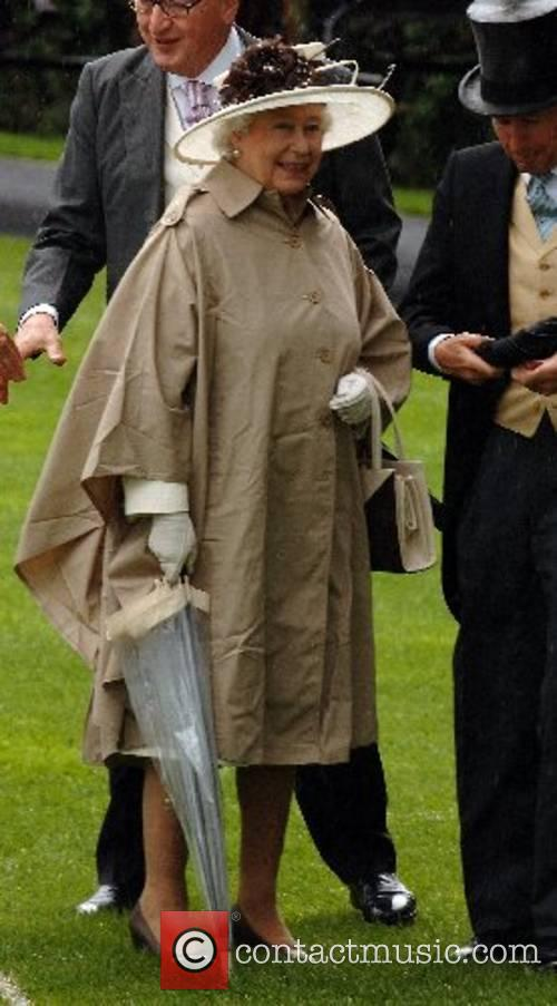 Queen Elizabeth ll attends a wet Ladies Day...