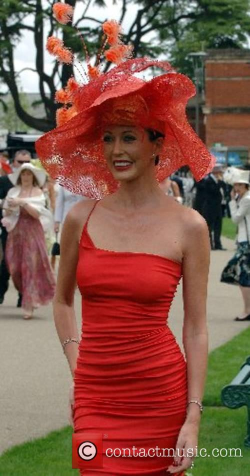 A racegoer wears an elaborate hat for Ladies...