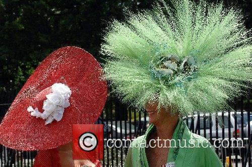 Racegoers wear elaborate hats for Ladies Day at...