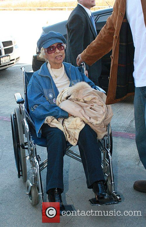 Ruby Dee arriving at American Airlines looking a...