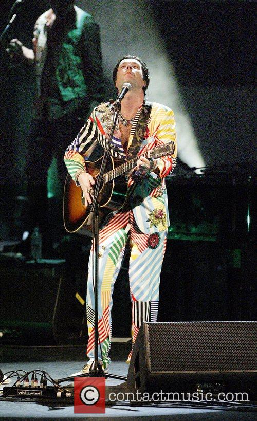 Rufus Wainwright and his band performing live in...