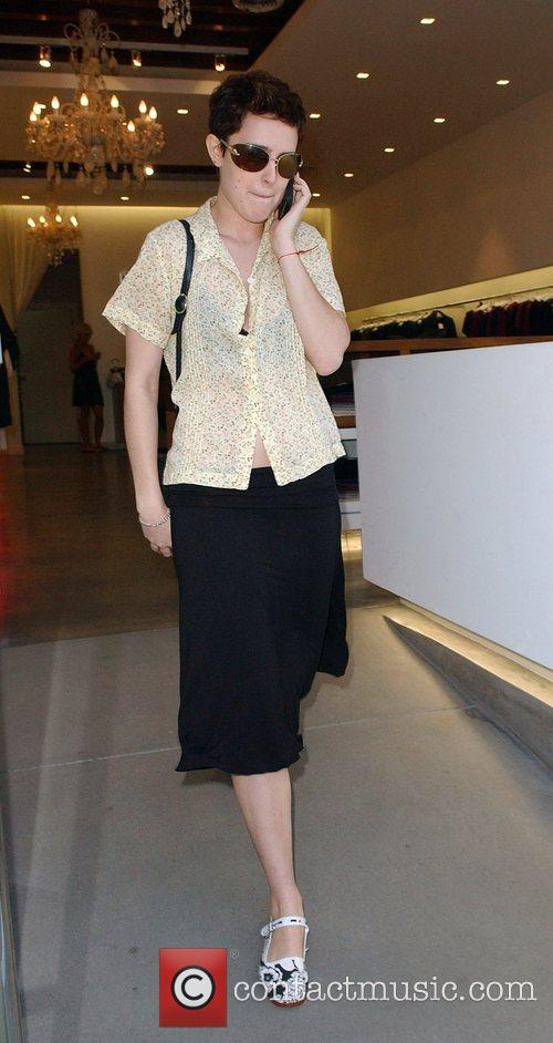 Rumer Willis talks into her cellphone while shopping...