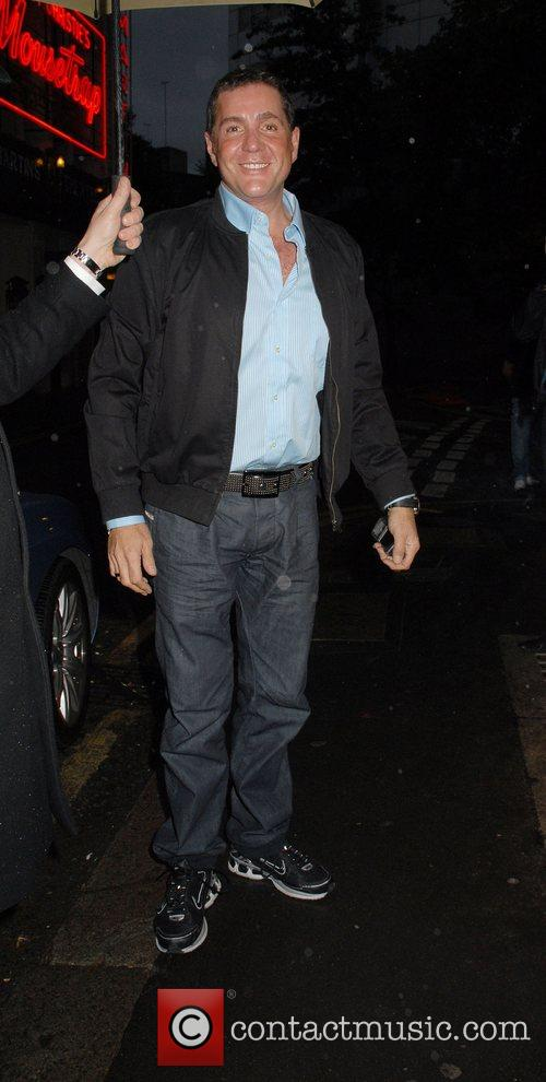 Dale Winton walking past The Ivy restaurant in...
