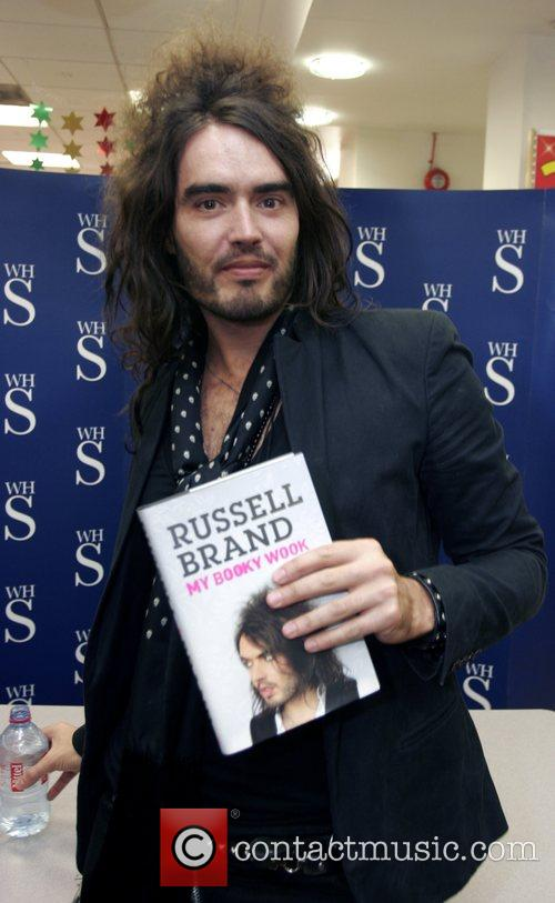 Russel Brand  signs his new book, 'My...