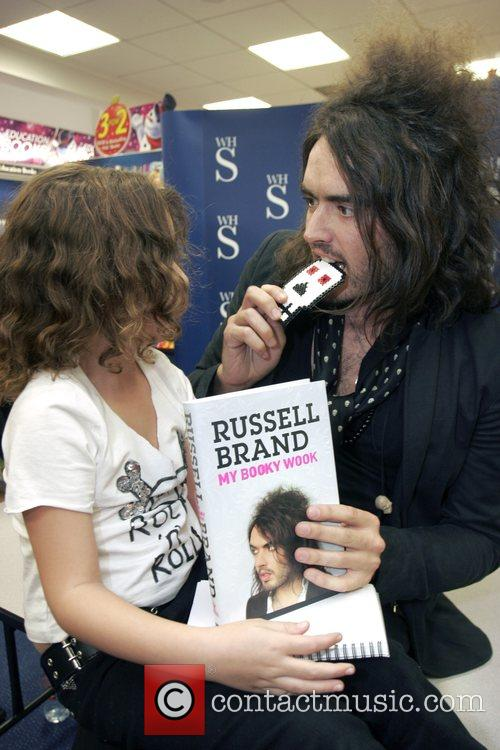 Signs his new book, 'My Booky Wook,' at...