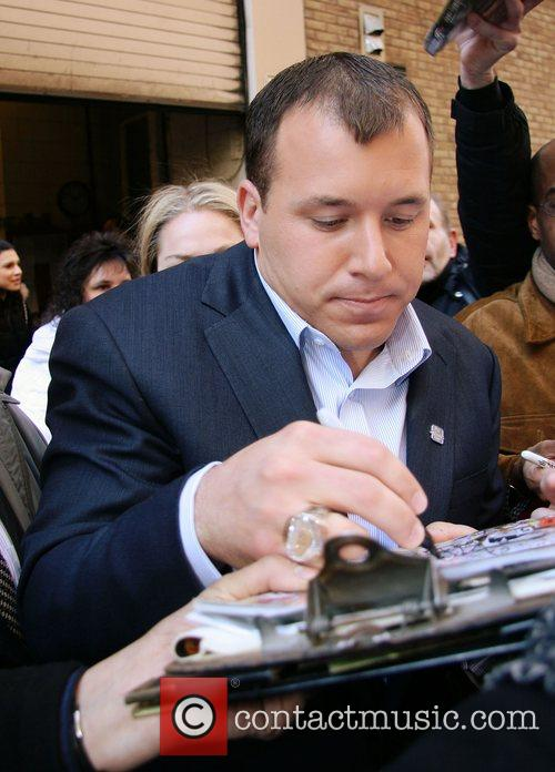Signs autographs while leaving ABC Studios after appearing...