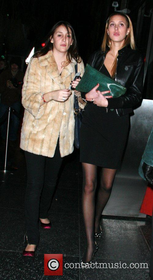 Whitney Port and friend leaving after attending a...