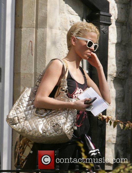 Sarah Harding leaving home on her way to...