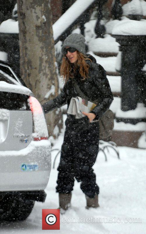 Leaving her Manhattan apartment during New York's first...