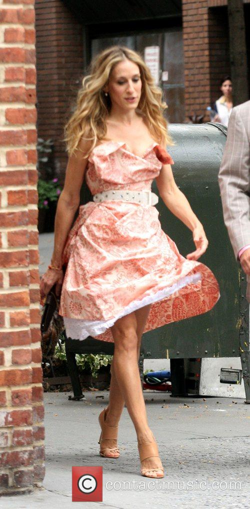 As the character 'Carrie Bradshaw' on the set...