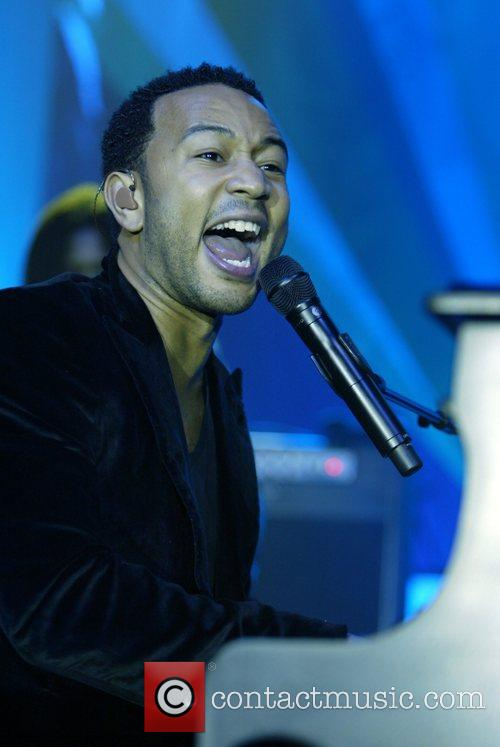 John Legend performing at the re-launch of School...