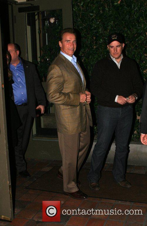 Arnold Schwarzenegger leaving Agos restaurant