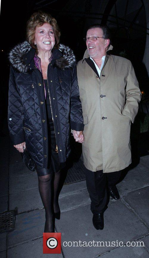 Cilla Black leaving Scotts restaurant holding hands with...