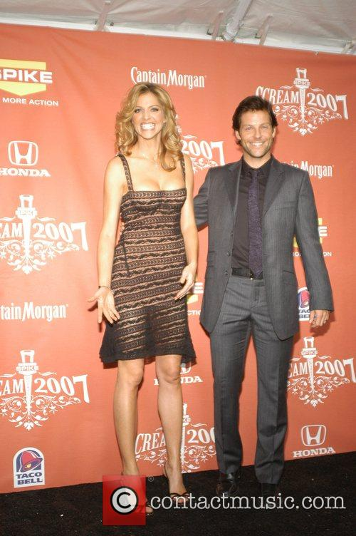 Tricia Helfer and Jamie Bamber 10