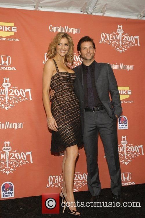 Tricia Helfer and Jamie Bamber 5
