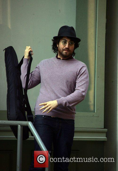 Sean Lennon picks up his guitar to leave...