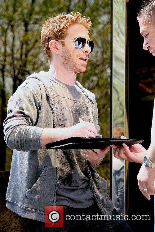 Seth Green signs autographs as he leaves his...